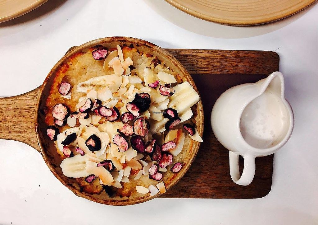 """Photo of Ginger Brown Cafe  by <a href=""""/members/profile/karlaess"""">karlaess</a> <br/>Vegan coconut and vanilla baked rice pudding with banana, freeze-dried blueberries and coconut milk <br/> March 19, 2018  - <a href='/contact/abuse/image/114974/373086'>Report</a>"""