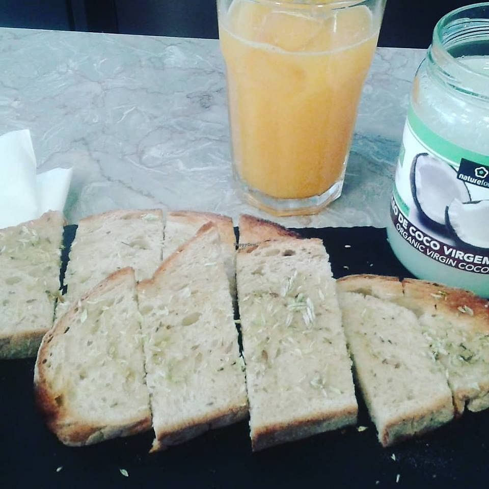 """Photo of Taverna do Merceeiro  by <a href=""""/members/profile/community5"""">community5</a> <br/>Coconut oil and oregano toast <br/> March 30, 2018  - <a href='/contact/abuse/image/115467/378510'>Report</a>"""