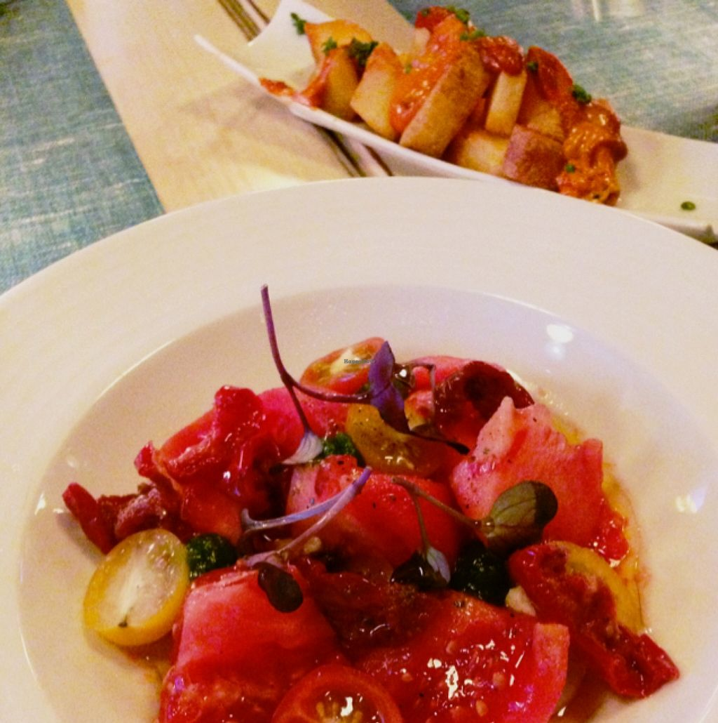 """Photo of Bon Lloc  by <a href=""""/members/profile/PJantbased"""">PJantbased</a> <br/>tomato salad with cashew cheese and crispy potatoes <br/> January 11, 2016  - <a href='/contact/abuse/image/1155/132122'>Report</a>"""