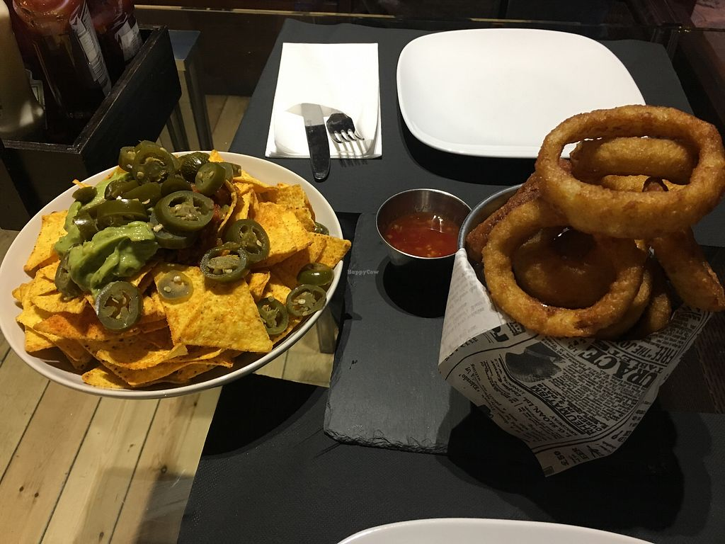 Photo of Dylan's  by HollyGraceWard <br/>Cheeseless nachos and onion rings for starters  <br/> March 27, 2018  - <a href='/contact/abuse/image/115799/376692'>Report</a>
