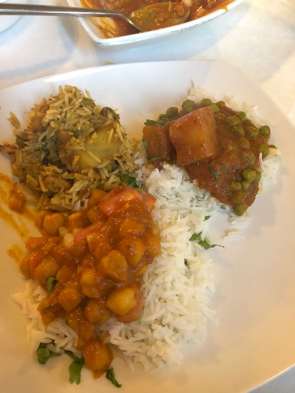 "Photo of Shahi Palace  by <a href=""/members/profile/Jadediana"">Jadediana</a> <br/>Vegetable Biryani (Left) , Alu Mater, and Chana Masala at the bottom  <br/> April 7, 2018  - <a href='/contact/abuse/image/115816/382153'>Report</a>"