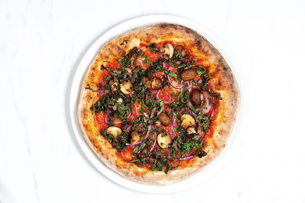"""Photo of Modern Market - 16203 N Scottsdale  by <a href=""""/members/profile/modernmarket"""">modernmarket</a> <br/>Crimini Kale Pizza. Daiya shredded mozzarella also available on request <br/> March 28, 2018  - <a href='/contact/abuse/image/116017/377441'>Report</a>"""