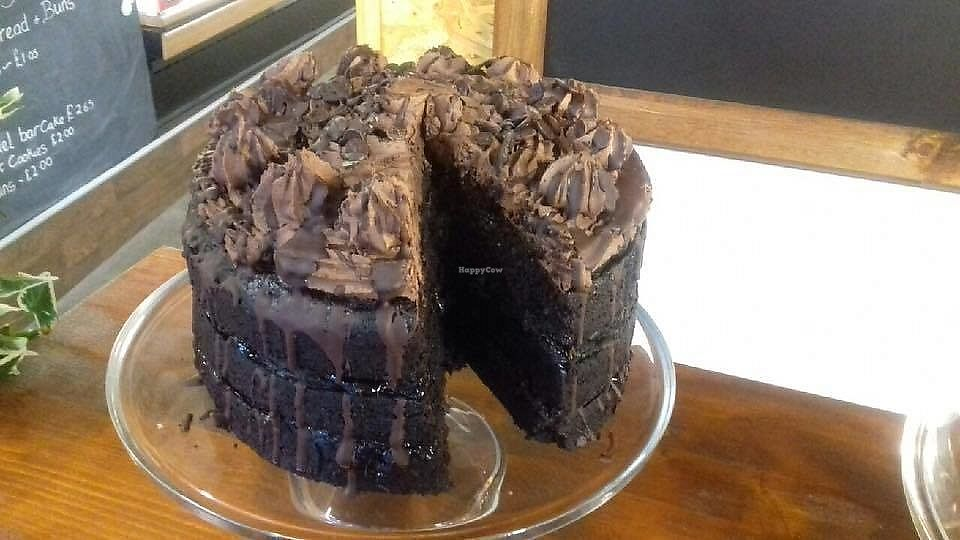 "Photo of The Green Guerrilla Deli  by <a href=""/members/profile/Veggie%20on%20the%20go"">Veggie on the go</a> <br/>Triple Layer Vegan Chocolate Cake with Black Cherry Compote <br/> March 29, 2018  - <a href='/contact/abuse/image/116050/377648'>Report</a>"