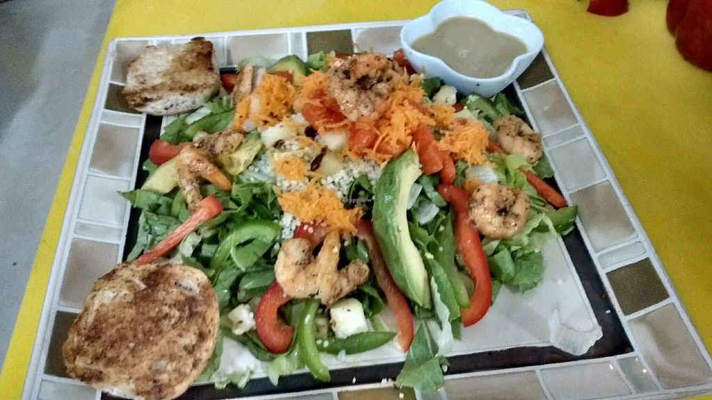 """Photo of Iguana Jaun's  by <a href=""""/members/profile/iguana-juans"""">iguana-juans</a> <br/>Island Vibe Salad: mixed greens, red & green pepper, carrots, avocado, cous-cous & pineapple jalapeño salsa and papaya (this customer added grilled shrimp) <br/> April 20, 2018  - <a href='/contact/abuse/image/116286/388328'>Report</a>"""