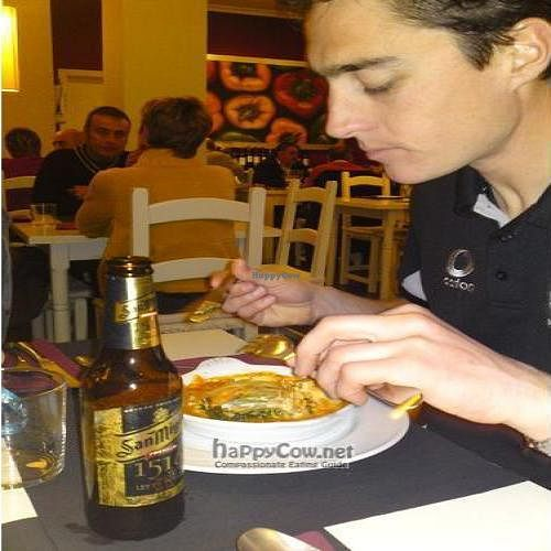 """Photo of Les Maduixes  by <a href=""""/members/profile/Vegan-Globetrotter"""">Vegan-Globetrotter</a> <br/>My friend Rob tucks into a vegetarian lasanga <br/> August 31, 2009  - <a href='/contact/abuse/image/1165/2565'>Report</a>"""