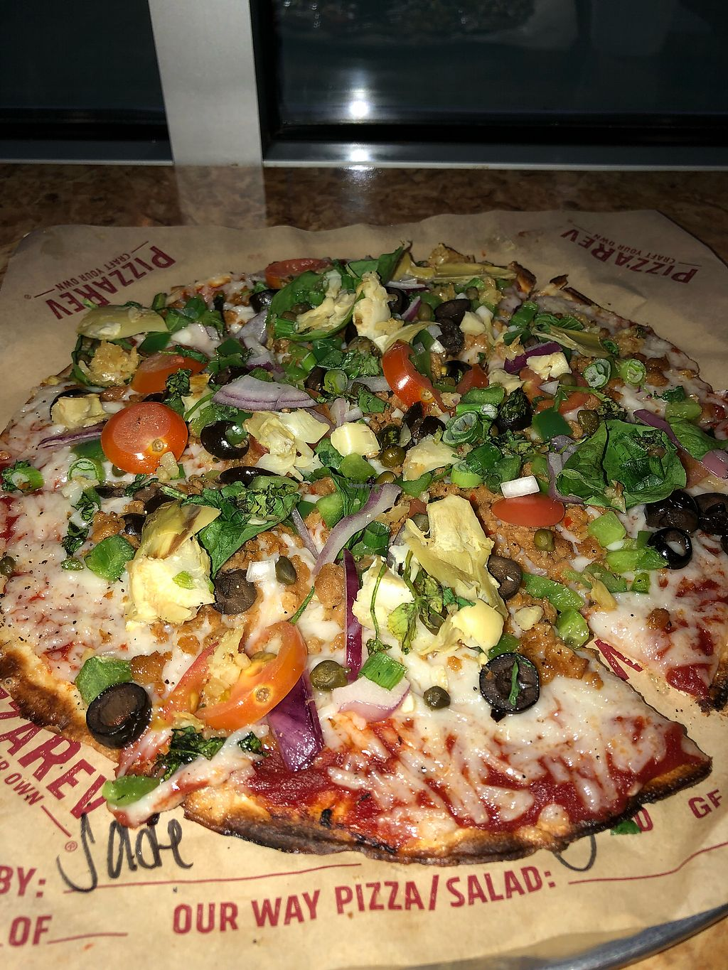 """Photo of PizzaRev  by <a href=""""/members/profile/Jadediana"""">Jadediana</a> <br/>Vegan pizza w/ cheese, sausage, veggies <br/> April 14, 2018  - <a href='/contact/abuse/image/116840/385513'>Report</a>"""