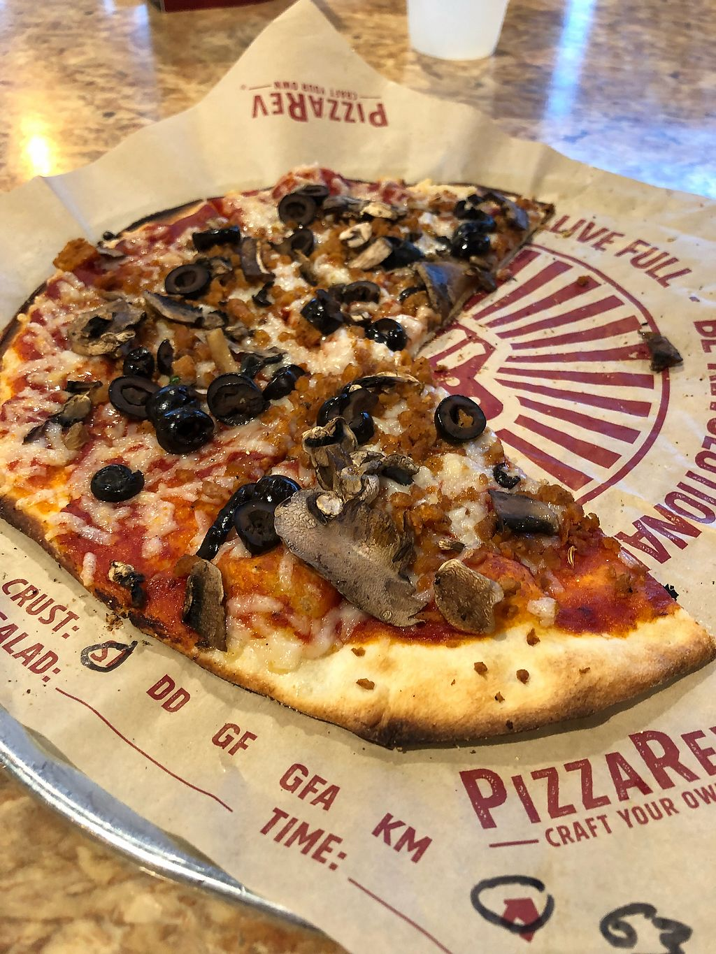"""Photo of PizzaRev  by <a href=""""/members/profile/Jadediana"""">Jadediana</a> <br/>Vegan pizza w/ cheese, sausage, mushrooms, and black olives  <br/> April 14, 2018  - <a href='/contact/abuse/image/116840/385515'>Report</a>"""