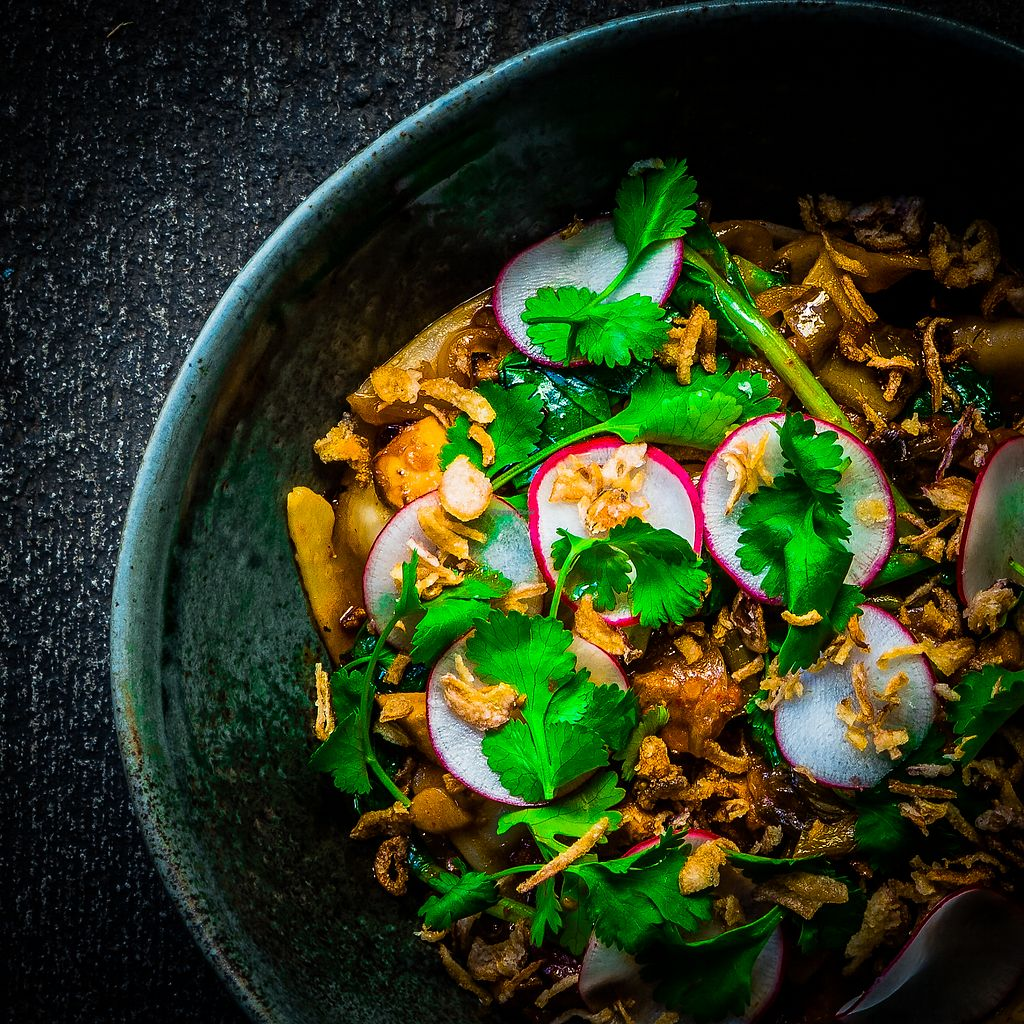 """Photo of M Kokko  by <a href=""""/members/profile/turtleveg"""">turtleveg</a> <br/>Biang Biang Noodles with Shiitake & Tofu, Yu Choi, Cucumber, Radish, Black Vinaigrette, Chili Oil <br/> April 18, 2018  - <a href='/contact/abuse/image/116972/387636'>Report</a>"""