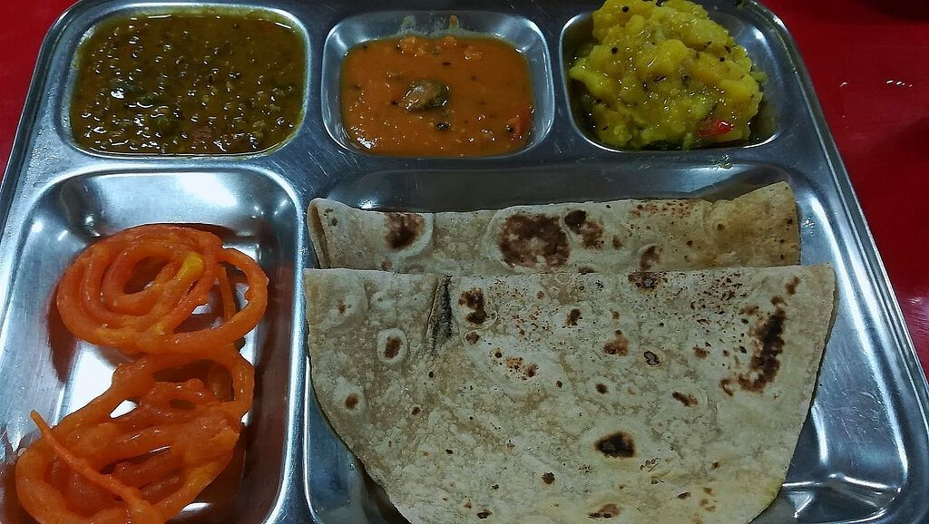 """Photo of Raja Punjabi - Food Stall  by <a href=""""/members/profile/ChoyYuen"""">ChoyYuen</a> <br/>Freshly made chapati with our choice of dishes.  <br/> April 11, 2018  - <a href='/contact/abuse/image/117118/383796'>Report</a>"""