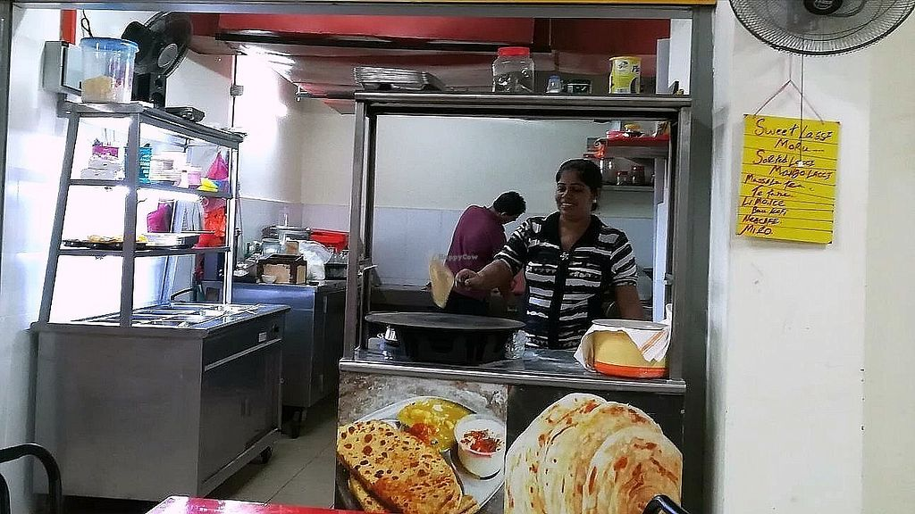 """Photo of Raja Punjabi - Food Stall  by <a href=""""/members/profile/ChoyYuen"""">ChoyYuen</a> <br/>Raj's assistant is making chapati.  <br/> April 11, 2018  - <a href='/contact/abuse/image/117118/383802'>Report</a>"""