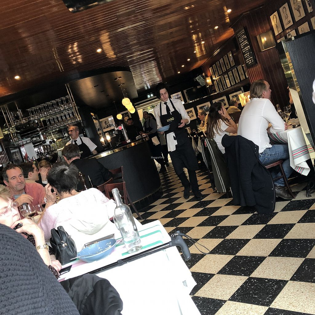 """Photo of Livio  by <a href=""""/members/profile/TARAMCDONALD"""">TARAMCDONALD</a> <br/>Interior of very popular Italian eatery <br/> April 13, 2018  - <a href='/contact/abuse/image/117588/384803'>Report</a>"""