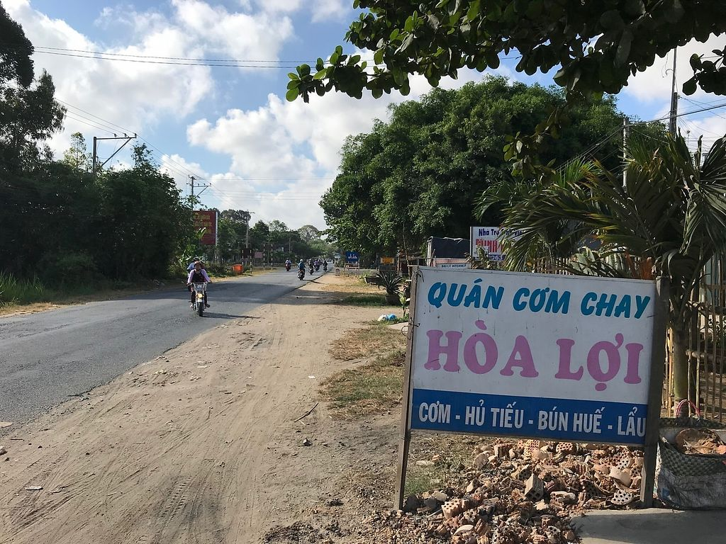 """Photo of Com Chay Hoa Loi  by <a href=""""/members/profile/flytheorient"""">flytheorient</a> <br/>Signage from main highway <br/> April 14, 2018  - <a href='/contact/abuse/image/117606/385473'>Report</a>"""