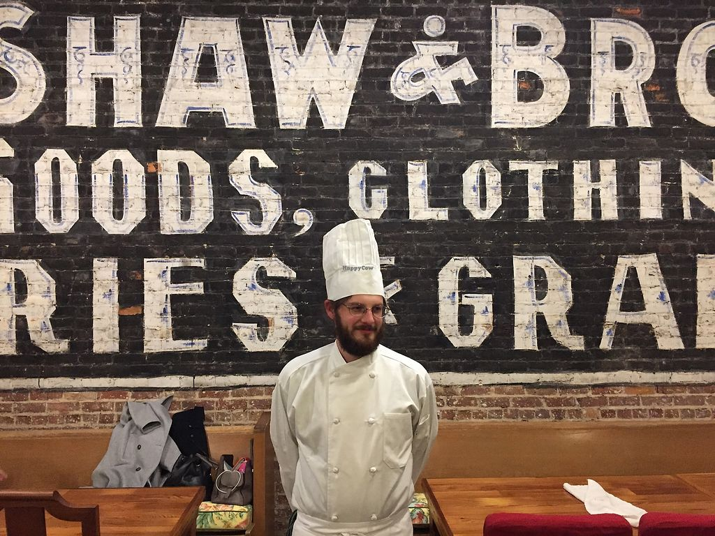 "Photo of Damfino's  by <a href=""/members/profile/FredHarris"">FredHarris</a> <br/>Chef Max fuzzily standing in front of the 1895 original advertisement in Damfino's, discovered when the wall was taken down during renovations.  <br/> April 13, 2018  - <a href='/contact/abuse/image/117626/385189'>Report</a>"