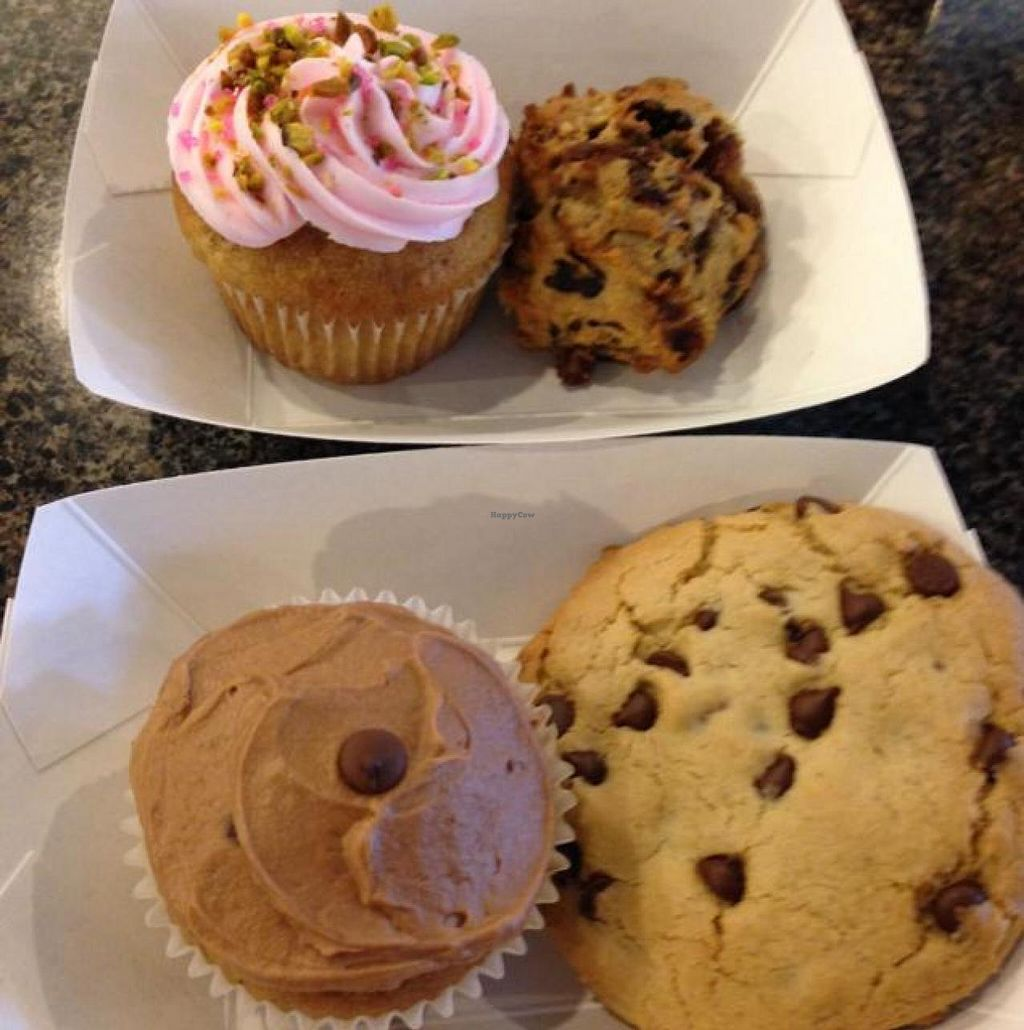 "Photo of CLOSED: Charlotte's Bakery  by <a href=""/members/profile/Lanahexapod"">Lanahexapod</a> <br/>a pistachio rosewater cupcake, a breakfast cookie, a banana chocolate chip cupcake and a chocolate chip cookie  <br/> June 11, 2014  - <a href='/contact/abuse/image/12020/71842'>Report</a>"