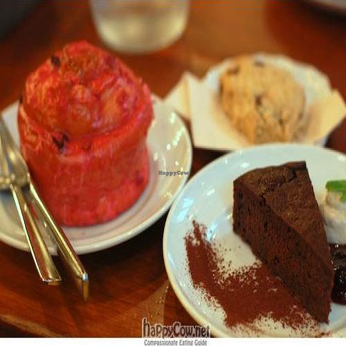"""Photo of Eat More Greens  by <a href=""""/members/profile/queenofpainting"""">queenofpainting</a> <br/>Chocolate cake with tofu cream, cranberry soy milk-glazed roll, chocolate chip cookie <br/> August 22, 2011  - <a href='/contact/abuse/image/12049/10238'>Report</a>"""