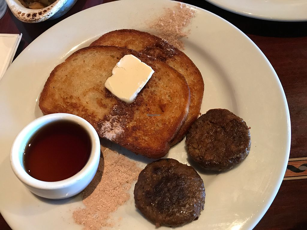 """Photo of Ethos Vegan Kitchen  by <a href=""""/members/profile/glassesgirl79"""">glassesgirl79</a> <br/>Vegan French toast with sausage patties  <br/> January 1, 2018  - <a href='/contact/abuse/image/12683/341744'>Report</a>"""