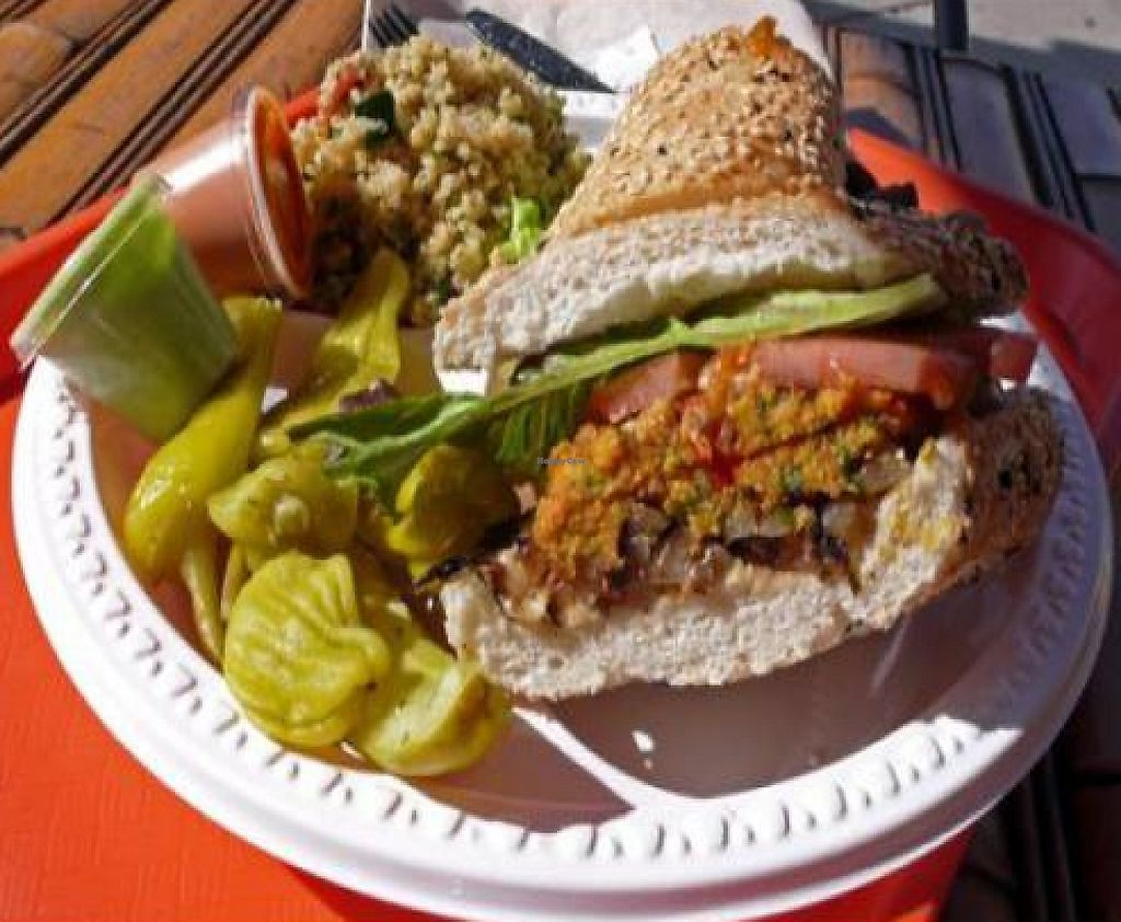"""Photo of CLOSED: HealthyCA  by <a href=""""/members/profile/quarrygirl"""">quarrygirl</a> <br/>Healthyca sausage: homemade vegan sausage on sesame roll with tomato, lettuce, grilled onion, tofu pesto and red pepper sauces <br/> December 26, 2011  - <a href='/contact/abuse/image/12736/189480'>Report</a>"""