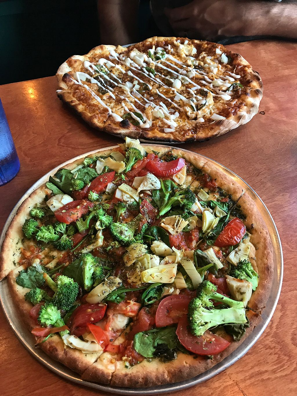 """Photo of Flatbread Pizza  by <a href=""""/members/profile/AmandaBoles"""">AmandaBoles</a> <br/>Vegan gf pizza on the bottom, topped with pesto mixed with their organic red sauce, local broccoli & tomatoes, artichokes and spinach.  <br/> November 4, 2017  - <a href='/contact/abuse/image/13104/321690'>Report</a>"""
