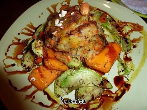 "Photo of Earth Cafe Marrakech  by <a href=""/members/profile/necropalice"">necropalice</a> <br/>Vegan burger served on a bed of baked root vegetables, sprinkled with almonds.   <br/> September 20, 2012  - <a href='/contact/abuse/image/13178/38061'>Report</a>"