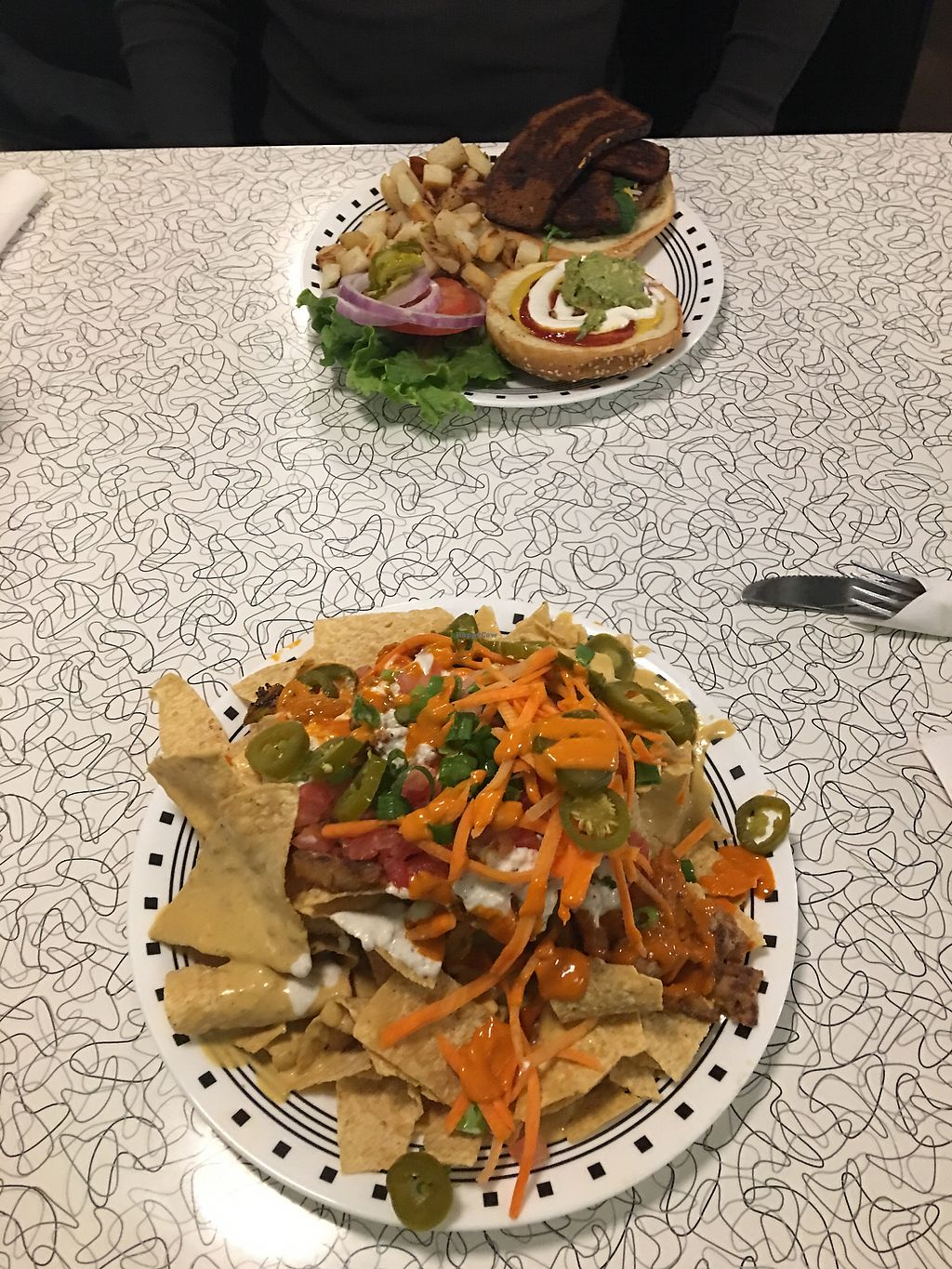"""Photo of Spiral Diner and Bakery  by <a href=""""/members/profile/EmilieP%C3%A9loquin"""">EmiliePéloquin</a> <br/>Buffalo spicy nachos and Spiral Burger <br/> February 18, 2018  - <a href='/contact/abuse/image/13232/360656'>Report</a>"""