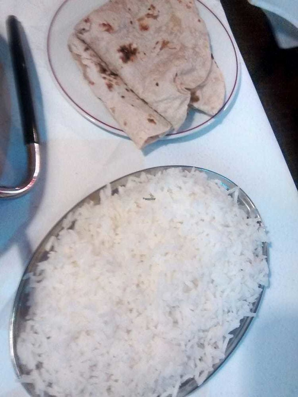 """Photo of The Rajah  by <a href=""""/members/profile/TrixieFirecracker"""">TrixieFirecracker</a> <br/>Chapattis and rice <br/> November 28, 2016  - <a href='/contact/abuse/image/13818/195449'>Report</a>"""