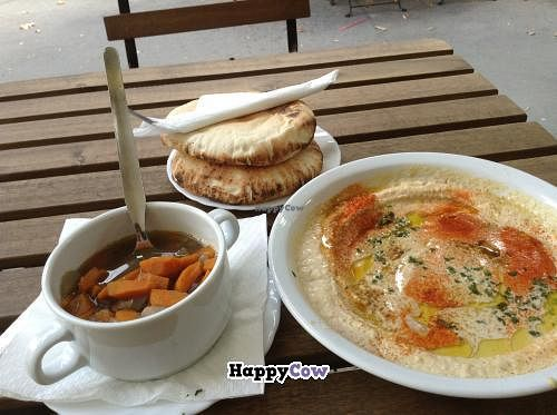 """Photo of Hummus Bar Vegetarian - Alkotmany  by <a href=""""/members/profile/Claudia6611"""">Claudia6611</a> <br/>Linsensuppe und Hummus mit Tahina- lecker!!!!! Sehr frisch, sehr nett, günstig. Unbedingt hingehen!!!! <br/> September 5, 2013  - <a href='/contact/abuse/image/13992/54456'>Report</a>"""