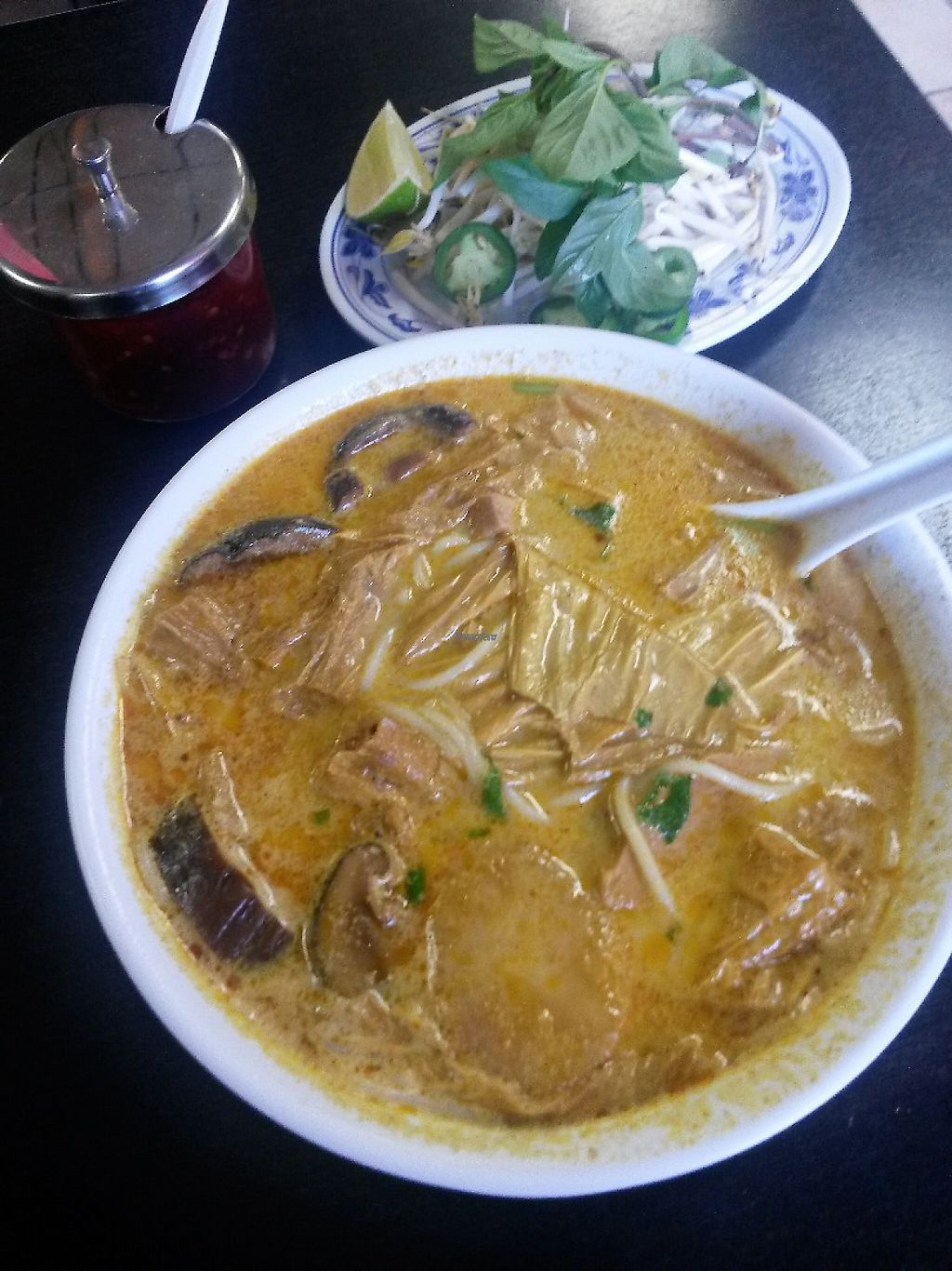 """Photo of Veggie Life Restaurant  by <a href=""""/members/profile/Taro"""">Taro</a> <br/>Curry with rice noodle soup, fresh sprouts and jalapeno and basil to top it.   <br/> February 8, 2017  - <a href='/contact/abuse/image/14017/224098'>Report</a>"""