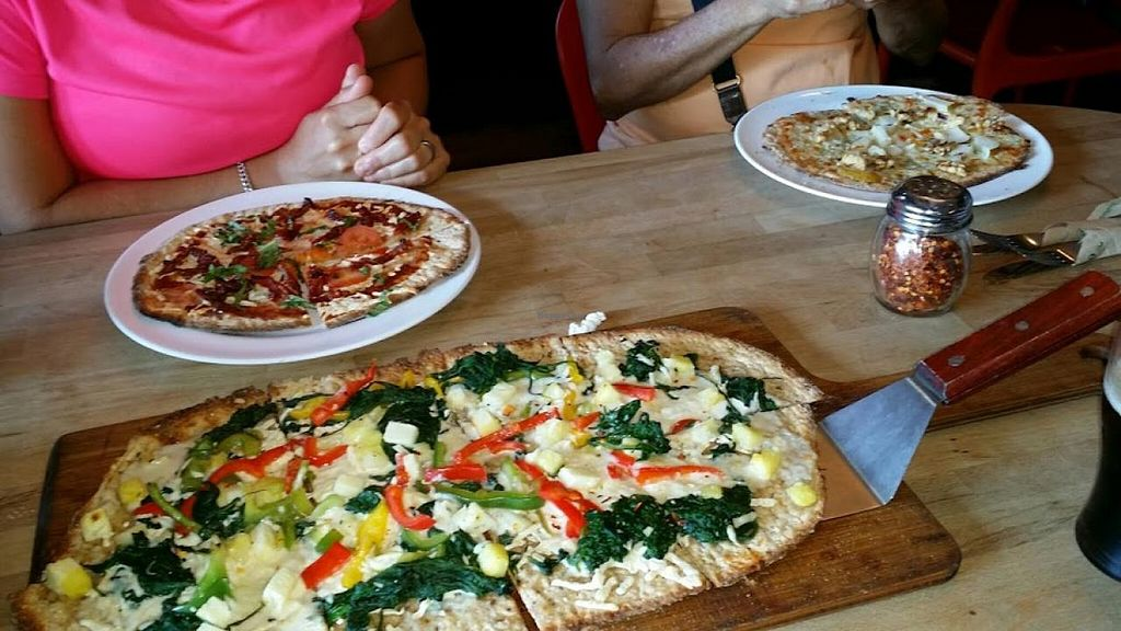 """Photo of Pizza Fusion  by <a href=""""/members/profile/maltinej"""">maltinej</a> <br/>2 vegan pizzas: A large Funky Fusion (peppers, spinach, soy chesse and daiya, pineapple on multi grain), and a personal soy/daiya, sun dried tomato, tomato and basil pizza  Non vegan friend got a Pear/Gorgonzola pizza.  <br/> October 26, 2014  - <a href='/contact/abuse/image/14156/83923'>Report</a>"""