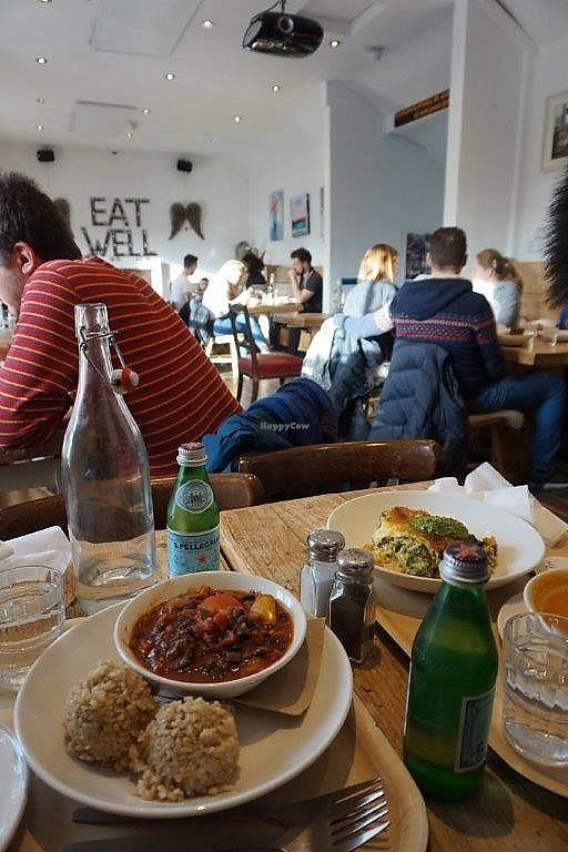 """Photo of The Happy Pear  by <a href=""""/members/profile/Shama2004"""">Shama2004</a> <br/>Fire place under """"EAT WELL"""" sign.  Spacious cozy eat-in room <br/> January 4, 2018  - <a href='/contact/abuse/image/14382/342826'>Report</a>"""