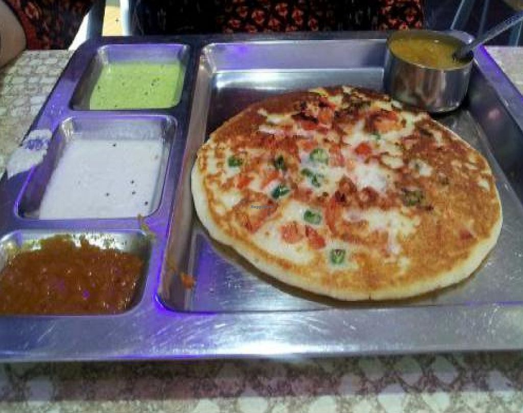 "Photo of Saravanaa Bhavan  by <a href=""/members/profile/Joyatri"">Joyatri</a> <br/>Tomato and green chili uttapam <br/> January 21, 2012  - <a href='/contact/abuse/image/14439/220981'>Report</a>"