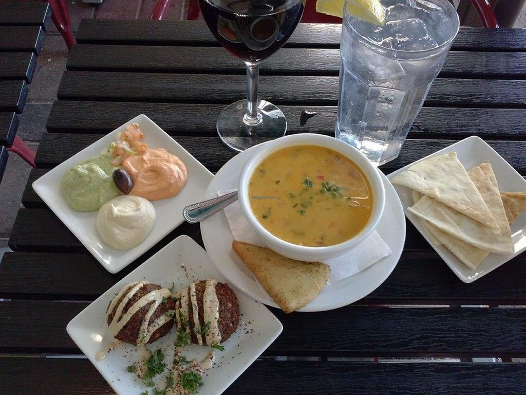 "Photo of Pita Jungle  by <a href=""/members/profile/MizSharon"">MizSharon</a> <br/>Curried coconut soup, hummus sampler, and falafel. Oh yeah! And a glass of Cabernet Sauvignon! I'm sitting outside and rock and roll playing and there's a water fountain too <br/> June 18, 2015  - <a href='/contact/abuse/image/1462/106430'>Report</a>"
