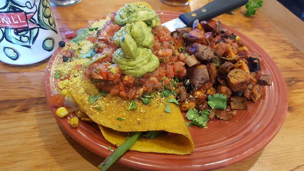 "Photo of Duluth Grill  by <a href=""/members/profile/Tots"">Tots</a> <br/>vegan omelette (made with chickpea flour) <br/> May 13, 2018  - <a href='/contact/abuse/image/14706/399339'>Report</a>"