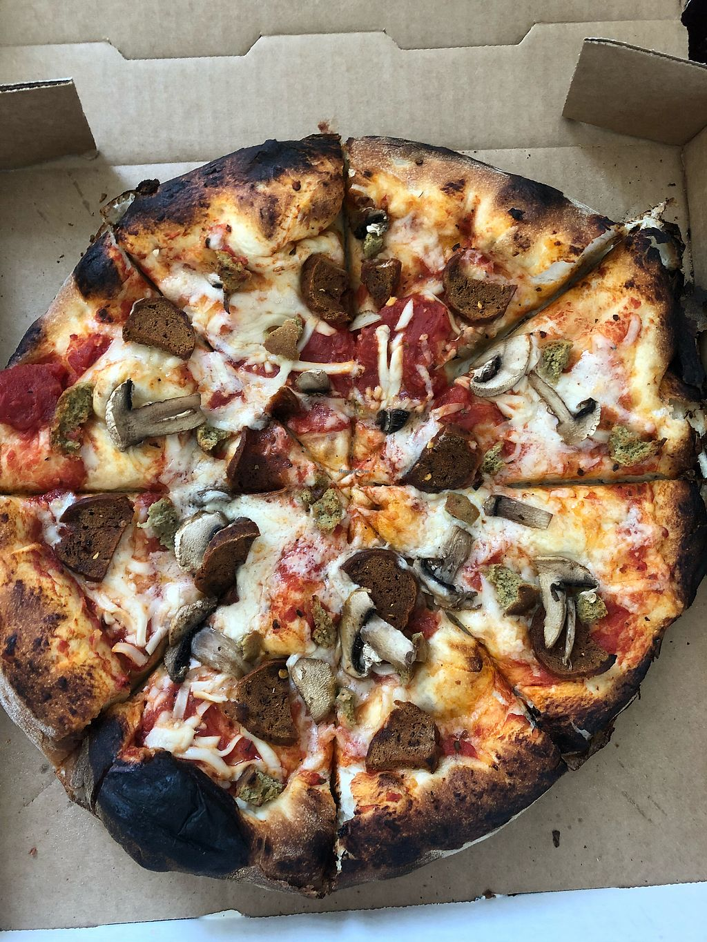 """Photo of The Parlor  by <a href=""""/members/profile/ArielRoberson"""">ArielRoberson</a> <br/>Pizza with vegan cheese, vegan sausage, and vegan pepperoni  <br/> February 6, 2018  - <a href='/contact/abuse/image/15520/355823'>Report</a>"""