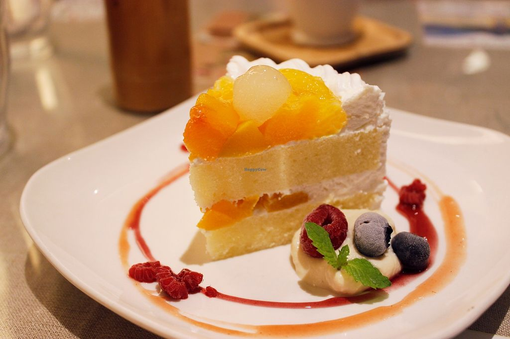 """Photo of Mumokuteki Cafe and Foods  by <a href=""""/members/profile/YukiLim"""">YukiLim</a> <br/>Vegan yellow cake with cream and fresh fruits.  <br/> July 16, 2017  - <a href='/contact/abuse/image/15812/280918'>Report</a>"""