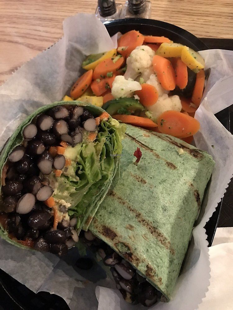 """Photo of Eden Vegan Cafe  by <a href=""""/members/profile/nlevine94"""">nlevine94</a> <br/>Black bean and avocado wrap with side veggies. HUGE portion, delicious too! <br/> November 11, 2017  - <a href='/contact/abuse/image/15842/324260'>Report</a>"""