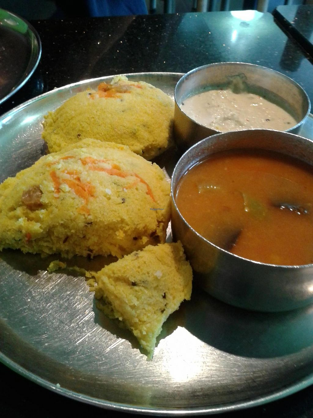 """Photo of Udupi Palace  by <a href=""""/members/profile/chobesoy"""">chobesoy</a> <br/>Kancheepurum Idli, a rice and lentil patty with cashews, ginger, coriander, available only on weekends <br/> October 24, 2014  - <a href='/contact/abuse/image/1605/83803'>Report</a>"""