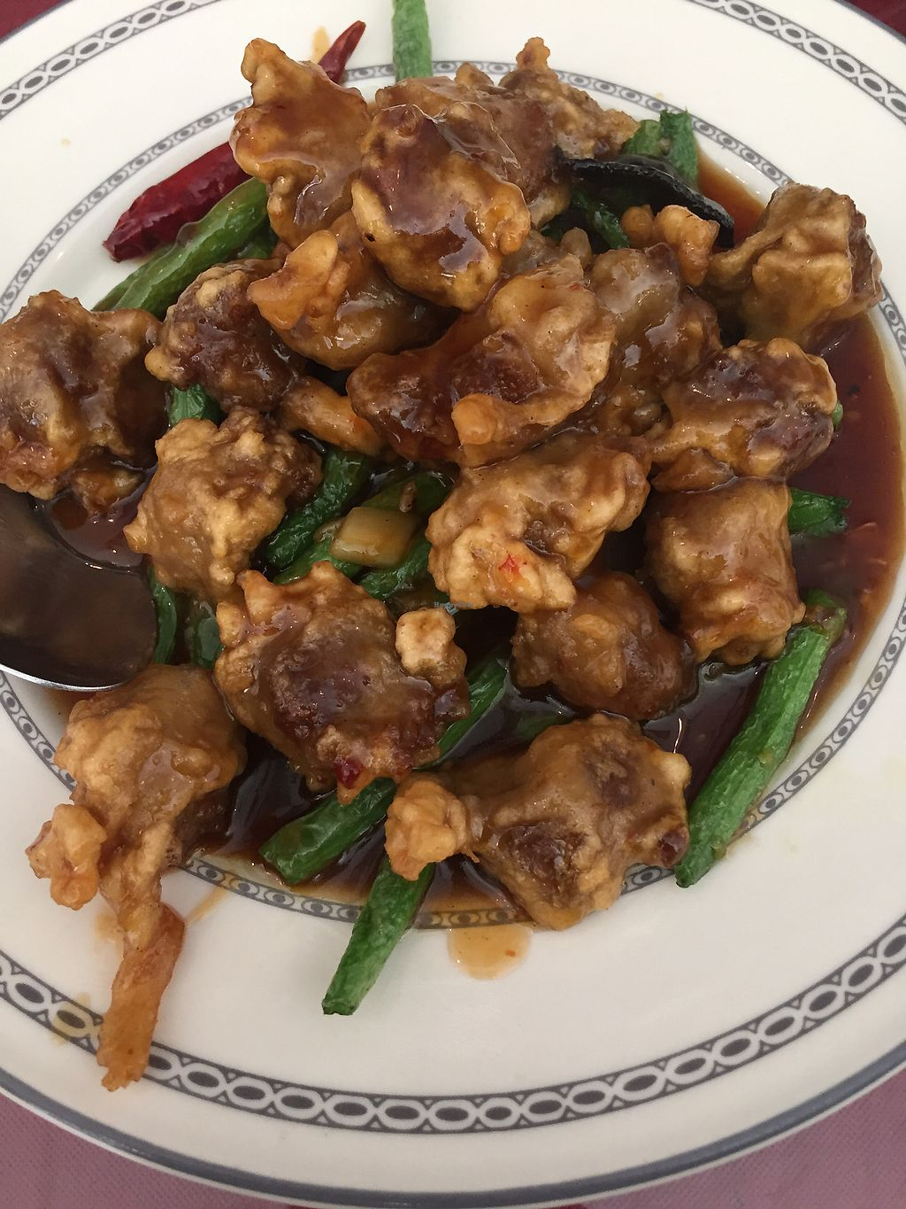 """Photo of Vegi Wokery  by <a href=""""/members/profile/R-MV"""">R-MV</a> <br/>Orange chicken  <br/> October 4, 2017  - <a href='/contact/abuse/image/1612/311814'>Report</a>"""