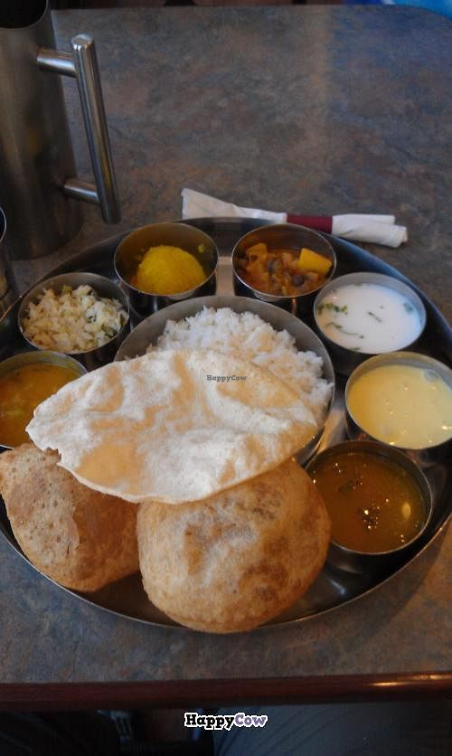 """Photo of Mylapore  by <a href=""""/members/profile/warmstorage"""">warmstorage</a> <br/>Weekend (allegedly vegan) thali. Milky dish on the right was the biggest question mark.  <br/> September 17, 2013  - <a href='/contact/abuse/image/16393/55096'>Report</a>"""