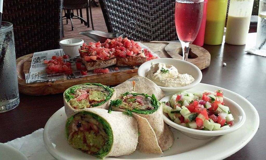"""Photo of Falafel Bistro and Wine Bar  by <a href=""""/members/profile/Deyson"""">Deyson</a> <br/>A lovely day at Falafel Bistro.  Thank you for such a wonderful meal.    This was a Vegan Falafel Wrap, A vegan version of Bruschetta, Vegan Sauces and Mimosas.   It was a a wonderful Sunday :) <br/> April 11, 2016  - <a href='/contact/abuse/image/16764/143924'>Report</a>"""
