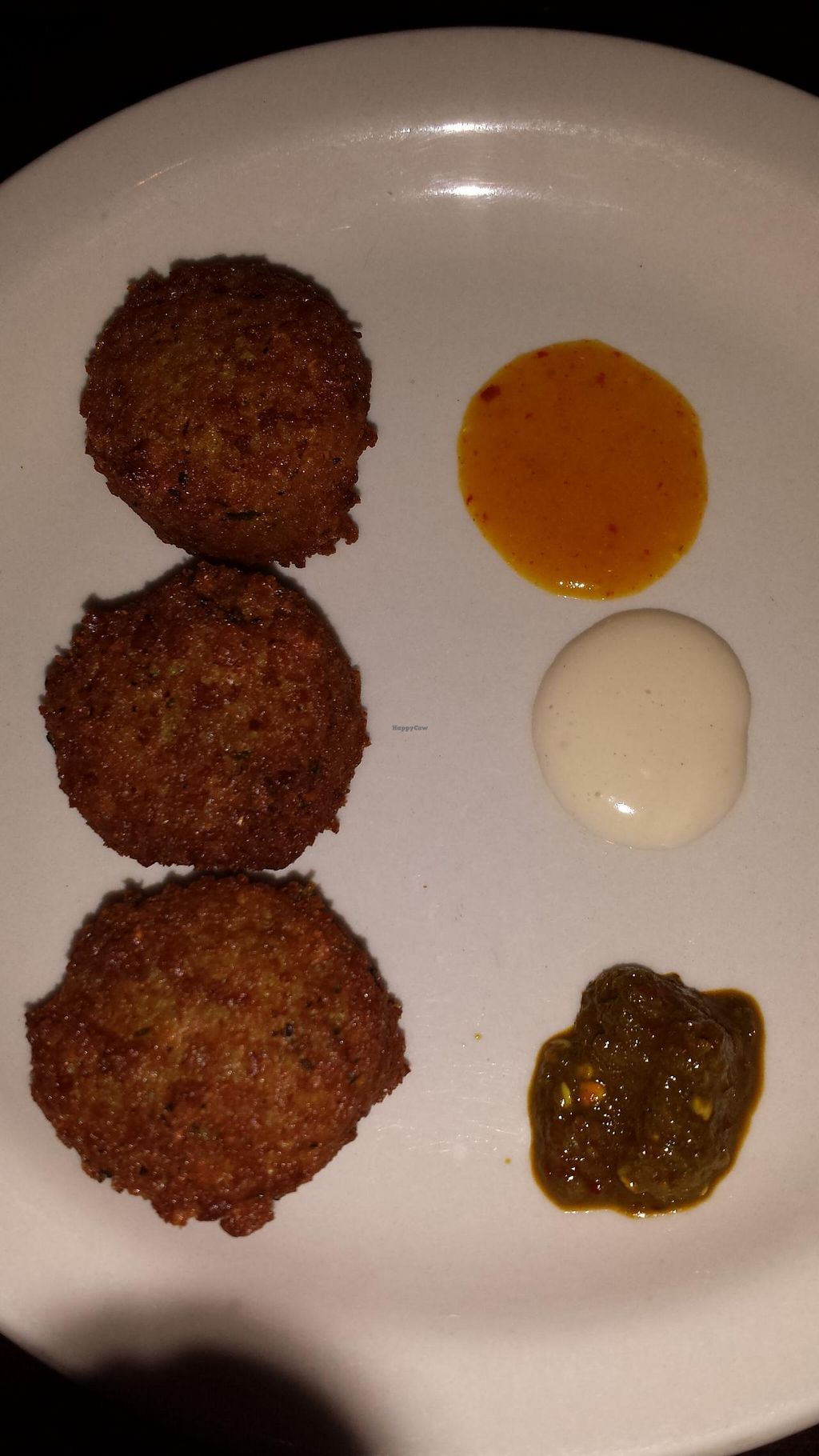 """Photo of Falafel Bistro and Wine Bar  by <a href=""""/members/profile/Michael%20X.%20James"""">Michael X. James</a> <br/>Falafel balls with sauces <br/> April 10, 2014  - <a href='/contact/abuse/image/16764/67340'>Report</a>"""