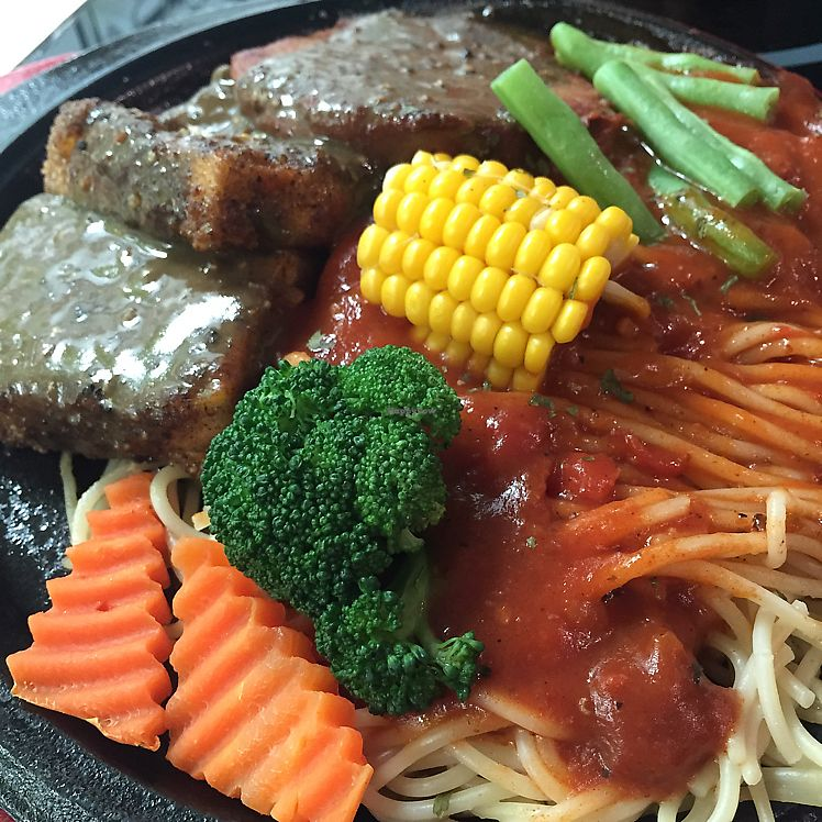 """Photo of Loving Hut - Guangfu South Rd  by <a href=""""/members/profile/HaileyPoLa"""">HaileyPoLa</a> <br/>Tofu & vegan steak  <br/> June 25, 2017  - <a href='/contact/abuse/image/17062/273232'>Report</a>"""