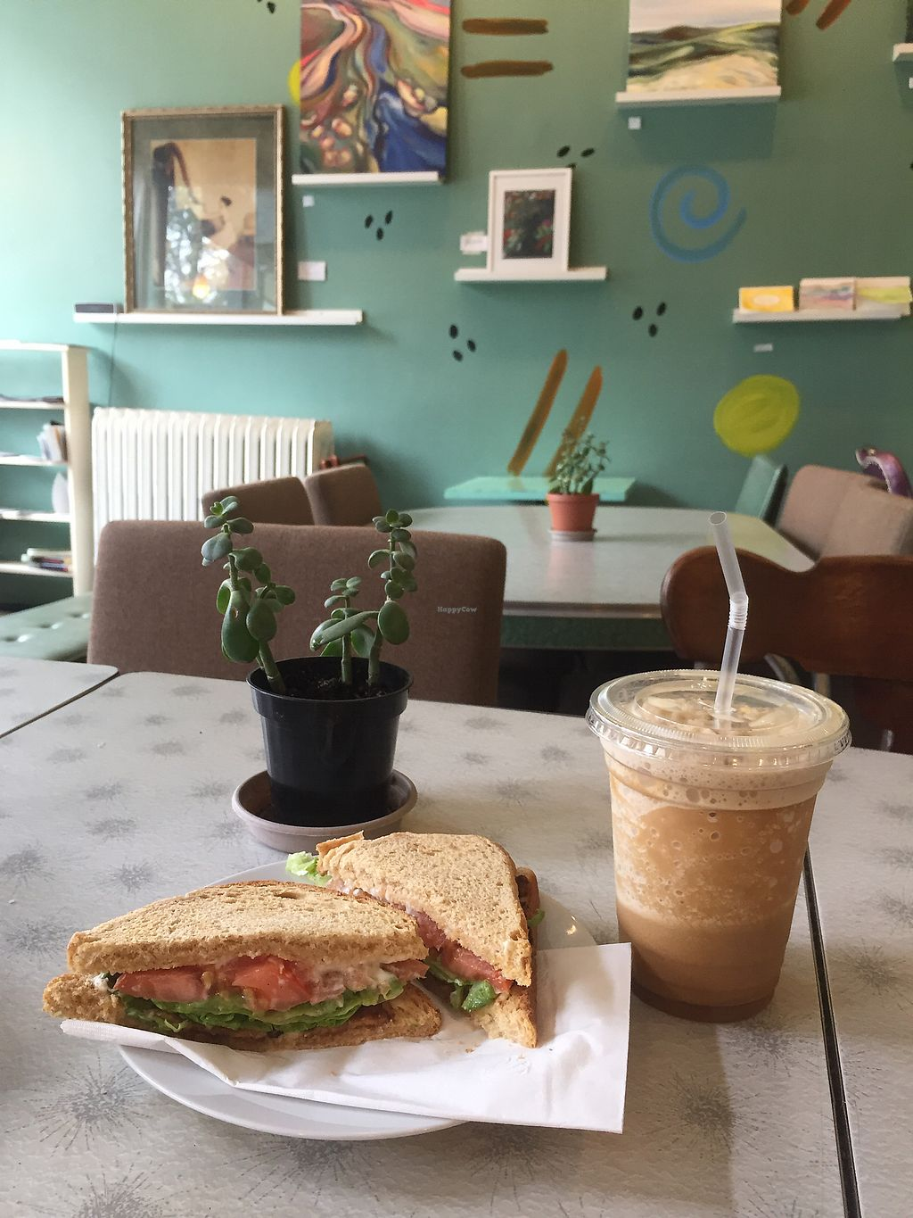 """Photo of Delicious Cafe  by <a href=""""/members/profile/happycowgirl"""">happycowgirl</a> <br/>Vegan BLT with avocado. Vegan coconut milk and coffee frappe.  <br/> August 4, 2017  - <a href='/contact/abuse/image/17202/288749'>Report</a>"""