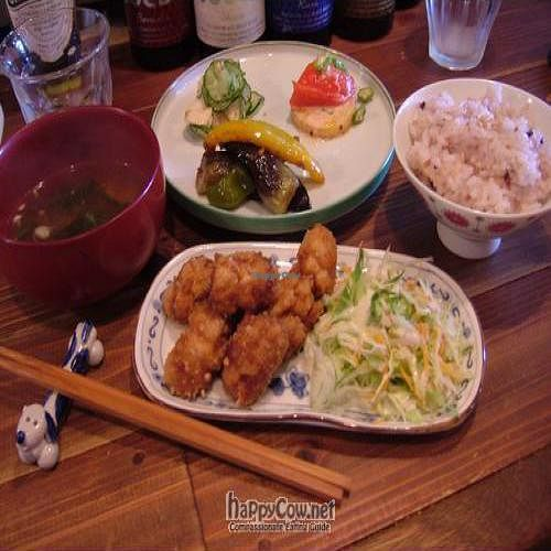 "Photo of Sunny Place  by <a href=""/members/profile/wanderingvegans"">wanderingvegans</a> <br/>Lunch Set with miso soup, salads, brown rice and gluten chicken <br/> April 25, 2010  - <a href='/contact/abuse/image/17467/4393'>Report</a>"