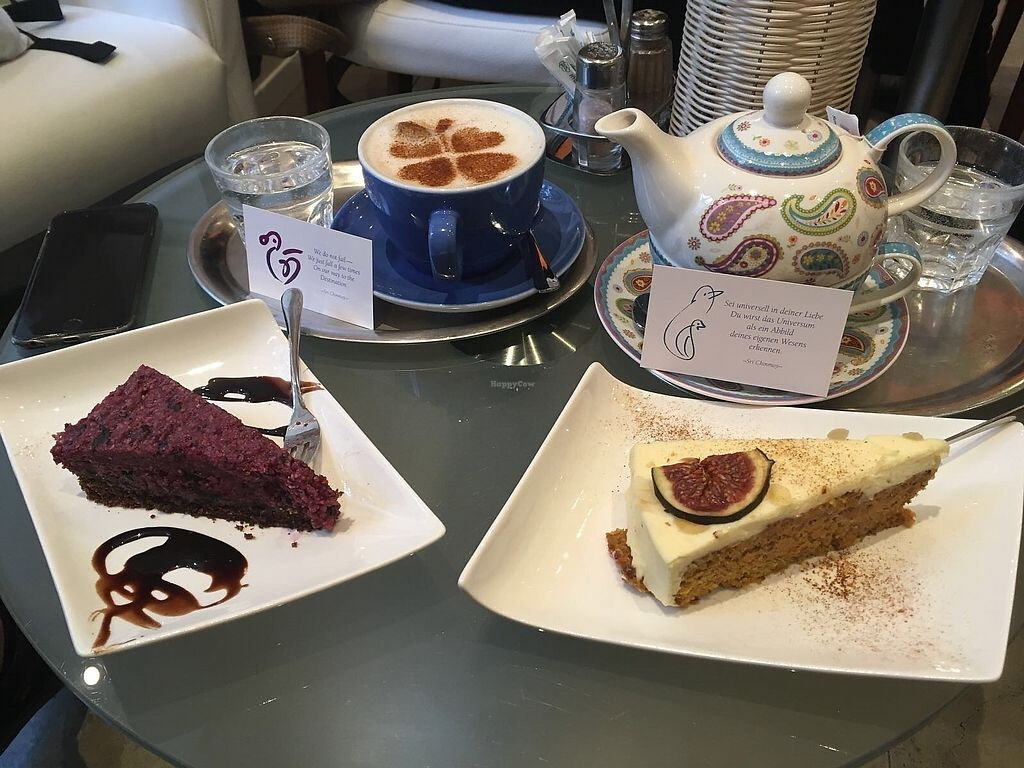 """Photo of The Heart of Joy Cafe  by <a href=""""/members/profile/ValentinaCarlotto"""">ValentinaCarlotto</a> <br/>Raw vegan cake, (vegetarian) carrot cake, tea and oat milk cappuccino <br/> January 1, 2018  - <a href='/contact/abuse/image/17506/341722'>Report</a>"""