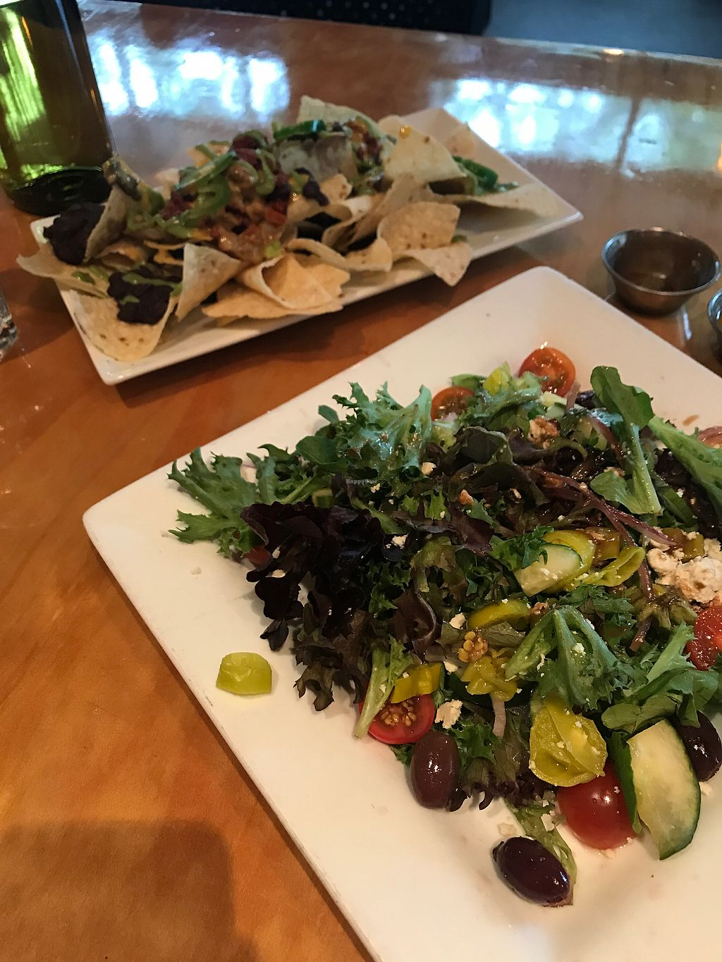 """Photo of Watercourse Foods  by <a href=""""/members/profile/ChynaCat"""">ChynaCat</a> <br/>Nachos and Greek Salad <br/> September 15, 2017  - <a href='/contact/abuse/image/1754/304576'>Report</a>"""