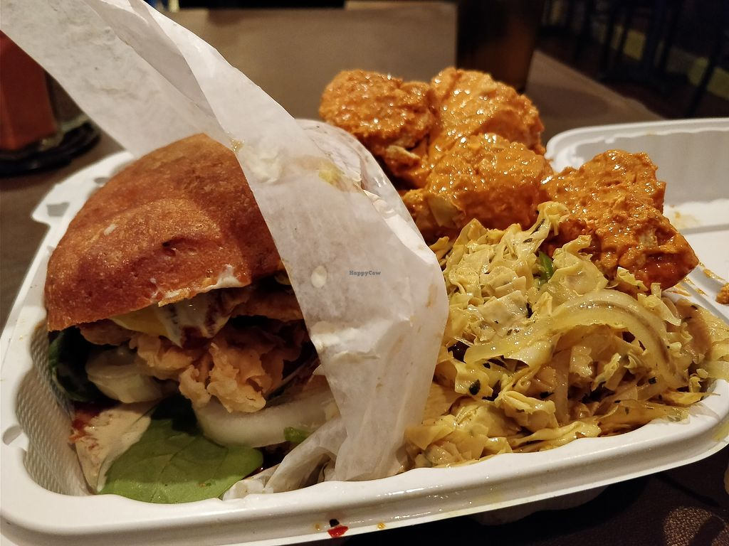 "Photo of NuVegan  by <a href=""/members/profile/einayim96"">einayim96</a> <br/>Fried Chicken Sandwich with Red Curry Tofu and Tofu Skins <br/> April 7, 2018  - <a href='/contact/abuse/image/1790/381753'>Report</a>"