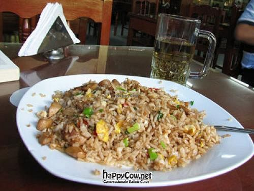 """Photo of El Paraiso Restaurant Vegetariano   by <a href=""""/members/profile/Scrablero"""">Scrablero</a> <br/>half-eaten plate of 'arroz chaufa' (Chinese-style rice) with mushrooms. Beverage (not beer) in background <br/> March 28, 2012  - <a href='/contact/abuse/image/17955/30004'>Report</a>"""