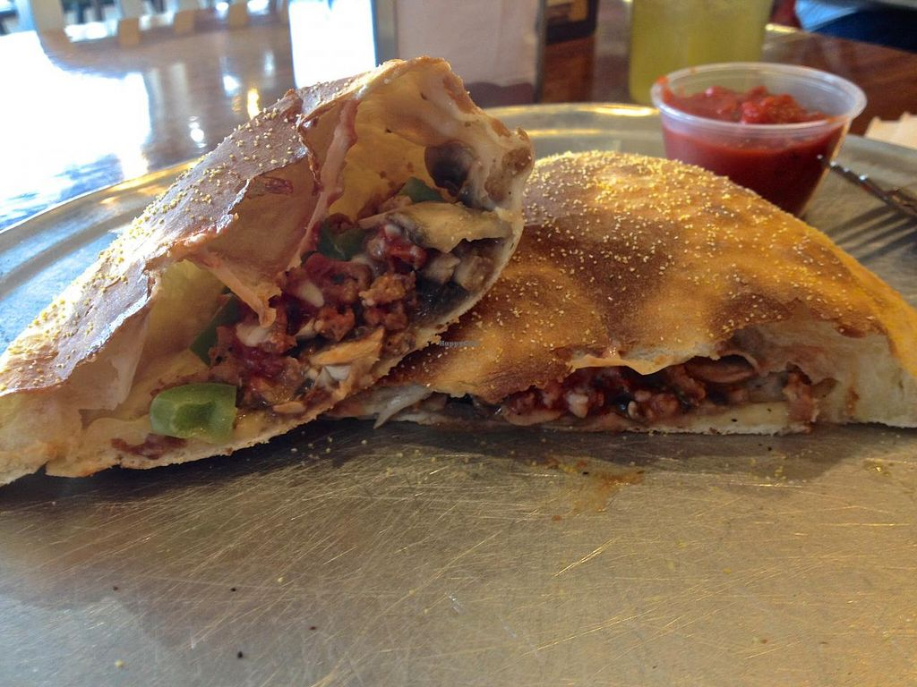 Photo of Classic Slice Pizza  by RamblingVegans <br/>Vegan calzone with vegan cheese, veggies and vegan sausage.   <br/> March 22, 2014  - <a href='/contact/abuse/image/18000/66337'>Report</a>