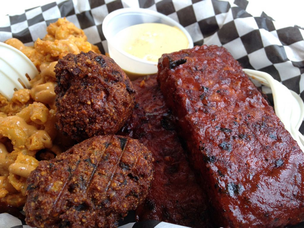 "Photo of CLOSED: Homegrown Smoker Vegan Barbecue - Food Cart  by <a href=""/members/profile/HeatherMeagher"">HeatherMeagher</a> <br/>tempeh ribs, mac and cheese, hush puppies-- amazing! <br/> July 22, 2016  - <a href='/contact/abuse/image/18080/161635'>Report</a>"