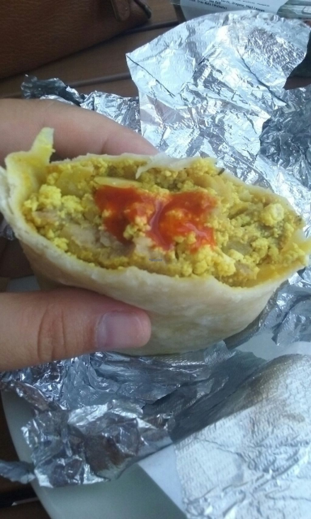 "Photo of Ever'man Cooperative Grocery and Cafe  by <a href=""/members/profile/veggie_htx"">veggie_htx</a> <br/>Vegan breakfast tofu scramble wrap <br/> August 17, 2016  - <a href='/contact/abuse/image/1850/169376'>Report</a>"